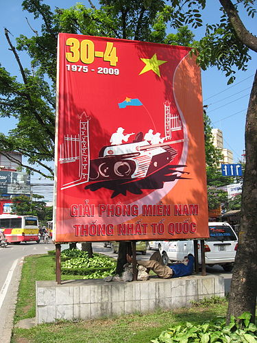 A sign near a Hanoi street in 2009, depicting the moment when an NVA tank crashed into the Presidential Palace 34 years earlier, on April 30, 1975. (Wikipedia)