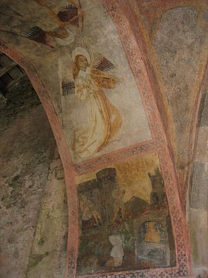 Audressein - Mural in the Audressein Church: an angel playing a medieval vielle with an archer.