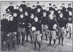 Arkansas Razorbacks football - The undefeated 1909 Arkansas Cardinals. QB Steve Creekmore is in front with Coach Hugo Bezdek at right (with the C sweatshirt).
