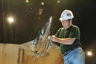 Arnold Air Force Base - Tim Wright examines an F-35 Lightning II Joint Strike Fighter model in the AEDC's 16-foot transonic wind tunnel, December 15, 2006.
