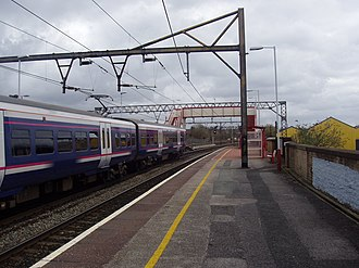 Ashburys railway station - Ashburys railway station in Manchester. The train shown is a Northern Rail Class 323 in First North Western livery.