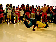 A bboy performing in a cipher for a crowd in Turkey.