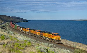 Diesel locomotive - A string of four diesel locomotives haul a long freight train in the U.S. state of Washington.