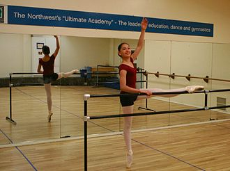 Glossary of ballet - Exercising at a portable barre. A fixed barre can be seen in the background.