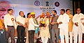 Bandaru Dattatreya presenting the memento to the best workers, at the inauguration of the Exhibition-cum-awareness programme on three years of Good Governance, in Hyderabad.jpg