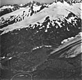 Bartlett Glacier, terminus of mountain glacier and hanging glaciers with bergschrund on the mountainsides, September 3, 1977 (GLACIERS 6551).jpg