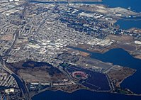 A bird's-eye view of the Bayview–Hunters Point neighborhood of San Francisco. Candlestick Park, demolished in 2015, is in the foreground