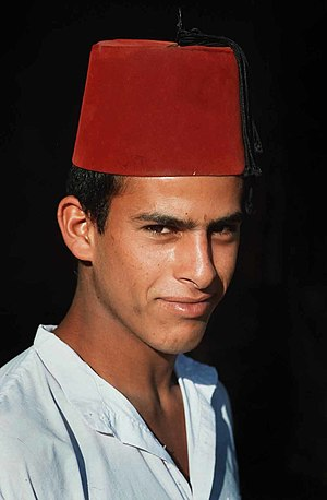Etiquette in the Middle East -  The Middle East contains a multitude of societies with different traditions regarding etiquette. Bedouins like this young man wearing a fez are traditionally renowned for their hospitality.