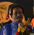 Bhagaban Behera being felicitated during 25th Odisha State Film Awards ceremony (cropped).JPG