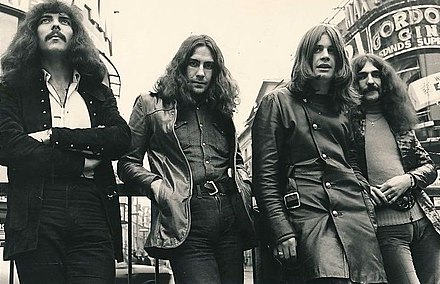 Black Sabbath at Piccadilly Circus, London in 1970. Left to right: Iommi, Ward, Osbourne, Butler Black Sabbath (1970).jpg