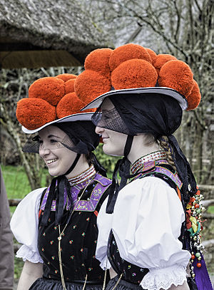 Black Forest gateau - Women in the traditional Black Forest costume, with the characteristic hats