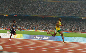 Athletics at the 2008 Summer Olympics – Men's 200 metres - Usain Bolt and Shawn Crawford in the closing stages of the final