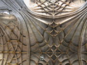 The flattened surface of this vault is supported by a multitude of decorative ribs called tierceron vaulting.