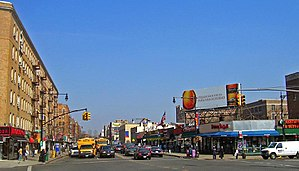 U.S. Route 9 in New York - Broadway at Dyckman Street in Inwood, looking north, with billboard in Spanish.