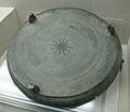 Bronze disk with three legs.jpg