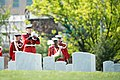 Bugler from Marine Barracks Washington (8th and I) plays Taps during the graveside service for US Marine Corps Maj. Elizabeth Kealey in Arlington National Cemetery 150427-A-ZZ999-012.jpg