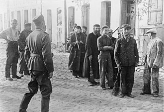 Labor camp - Polish Jews are lined up by German soldiers to do forced labour, September 1939, Nazi-occupied Poland