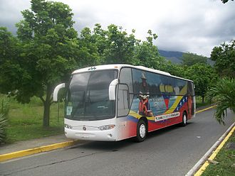 """Venezolana de Televisión - Coach bus operated by VTV bearing the channel's logo: """"El Canal de todos los venezolanos""""."""
