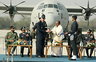 A. K. Antony - Defence Minister AK Antony with Chief of Staff of the US Air Force Norton Schwartz presenting a model of the C-130J Super Hercules  in 2011