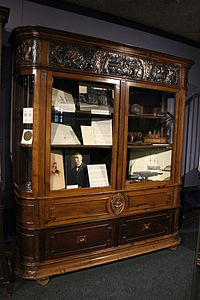 Cabinet made of the wreckage of HMS Foudroyant and containing objects also made of the same ship.JPG