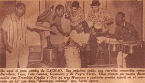 "Cachao - Cachao and his band, as depicted on the March 1961 edition of the Cuban Show magazine. Left to right: Cachao (bass), Gustavo Tamayo (güiro), Tata Güines (tumbadora), Alejandro ""El Negro"" Vivar (trumpet), Rogelio ""Yeyo"" Iglesias (bongos) and Guillermo Barreto (timbales). This picture was taken during the same photo shoot that yielded the cover of Cuban Jam Sessions in Miniature."