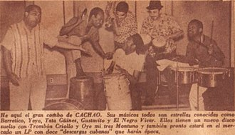 """Descarga - Cachao and his band, as depicted on the March 1961 edition of the Cuban """"Show"""" magazine. Left to right: Cachao (bass), Gustavo Tamayo (güiro), Tata Güines (tumbadora), Alejandro """"El Negro"""" Vivar (trumpet), Rogelio """"Yeyo"""" Iglesias (bongos) and Guillermo Barreto (timbales). This picture was taken during the same photo shoot that yielded the cover of Cuban Jam Sessions in Miniature."""