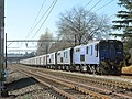 Car carrier train headed by Transnet Class 18-036, 18-008 and 18-130 Staged at Balgowan after a hook up. (16560714053).jpg