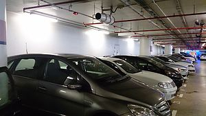 Parking guidance and information - Ultrasonic sensors above each lot in this indoor car park determine if a car has already taken the lot and indicate using leds; and some can send a Bluetooth/SMS message with the parking space number or code.