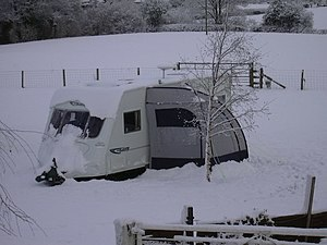 English: Caravan in the snow at Birch Hill Far...