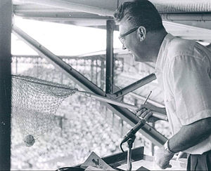 Harry Caray - Caray using his net to catch a foul ball in the Cardinals broadcast booth, 1957. He continued this practice when he worked for other teams.