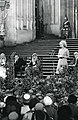 Carl Albert, Margaret Thatcher, and members of Parliament seated in front of a large cathedral.jpg