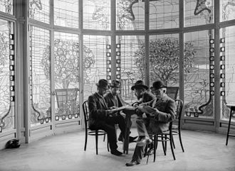 Casa Lleó Morera - Interior of Barcelona's Casa Lleó Morera covered gallery (1st floor). The stained glass was made by Antoni Rigalt i Blanch, the picture was taken by Baldomer Gili i Roig (2nd from the right)