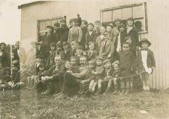 Service Civil International - Pierre Cérésole sitting amidst children at Brynmawr