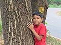 Child hugging tree at Peravoor (2).jpg