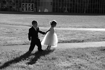 Black and white image of 2 children at wedding