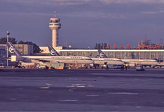 Ürümqi Diwopu International Airport - Ürümqi Airport in 1999, showing a lineup of Xinjiang Airlines Boeing 757s
