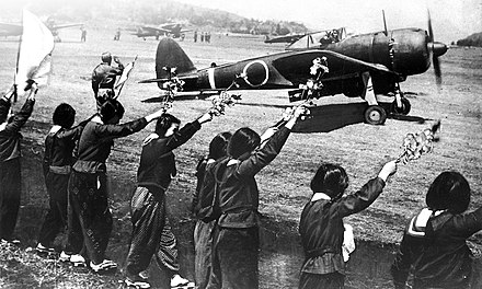 Chiran high school girls wave farewell with cherry blossom branches to departing kamikaze pilot in a Nakajima Ki-43-IIIa Hayabusa. Chiran high school girls wave kamikaze pilot.jpg