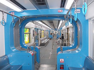 Line 3, Chongqing Rail Transit - Interior of a Line 3 train showing open gangway design.