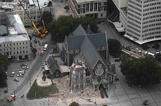 ChristChurch Cathedral, Christchurch - ChristChurch Cathedral the day after the February 2011 earthquake collapsed its spire (note the round rose window still intact)