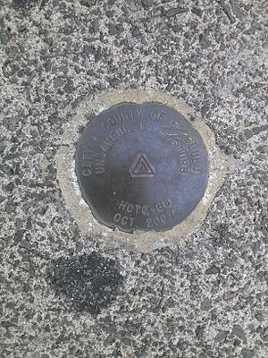 Honolulu Rail Transit - Honolulu High-Capacity Transit Corridor survey marker in the sidewalk at the corner of Kapiolani Blvd and Keeaumoku Street in Honolulu