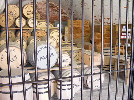 Barrels of salt beef and other products in a reconstruction of an American Civil War stockpile, at Fort Macon State Park, North Carolina Civil War rations.jpg