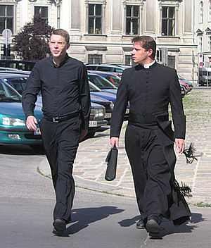 Clerical clothing - On the right, an example of the full collar shirt and cassock; on the left, a clerical shirt that could have a tab collar inserted.