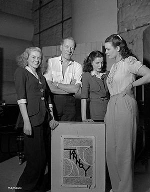 Tannoy - Actor Cyril Ritchard and three young women listen to the Tannoy public address system in 1948.