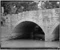 DETAIL VIEW OF EAST ARCH - Wrightstown Bridge, Spanning East River, on Mallard Road, Wrightstown, Brown County, WI HAER WIS,5-WRITO,1-2.tif