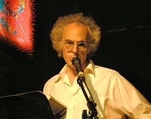 David Gates speaks into the microphone at Bowery Poetry Club in New York City.