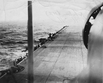 Merchant aircraft carrier - Fairey Swordfish landing on the deck of the Empire MacKay in the North Atlantic in 1944