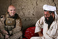 Defense.gov News Photo 100807-M-7038Y-028 - U.S. Marine Corps Capt. Sean Barnes left with 3rd Battalion 1st Marine Regiment Regimental Combat Team 7 listens as an Afghan National Army.jpg