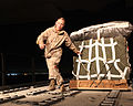 Defense.gov News Photo 110320-M-KL854-055 - U.S. Marine Corps Cpl. Sherri A. Townsend an air delivery specialist with Air Delivery Platoon 2nd Marine Logistics Group pulls a container of.jpg