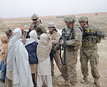 Defense.gov News Photo 120121-F-SA682-056 - Members of Kandahar Provincial Reconstruction Team hand out pens to Afghan children during a site assessment of the Dowry Rud Check Dam in Kandahar.jpg