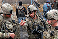 Defense.gov News Photo 120201-A-BF670-003 - U.S. Army Capt. Joe Pazcoguin 2nd from right talks with 1st Lt. Austin Cattle right and 1st Lt. Mitchell Creel during a clearance operation in.jpg
